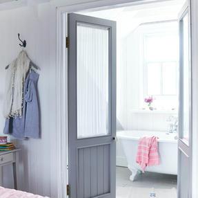 Glazed doors lead on to this ensuite bathroom
