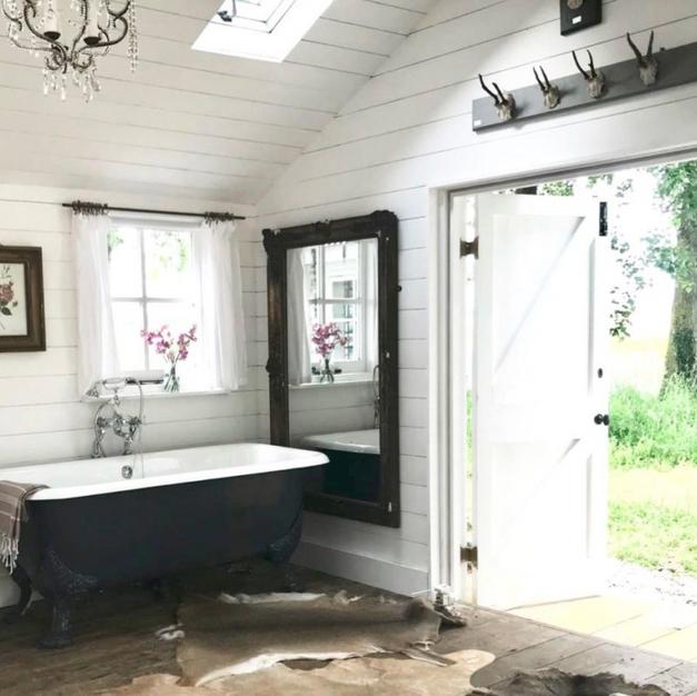 `elegant roll top bath in a rustic cabin