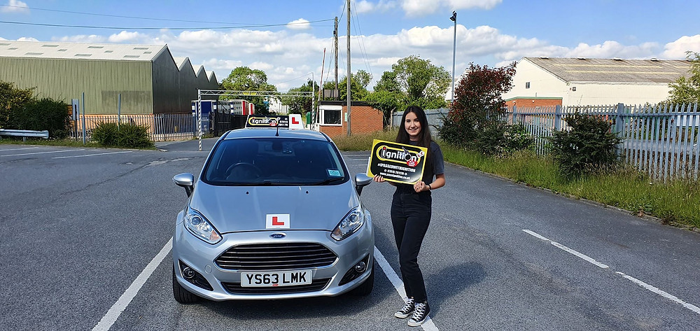 Tamzin from Kirkby happy after passing her test first time following driver training with Dave Jowett ADI