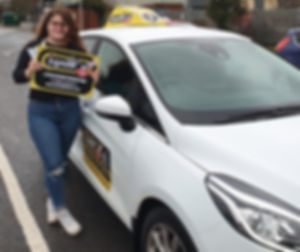 Lauren Griffin from Somercotes passing her test with her driving instructor Dave Jowett AD