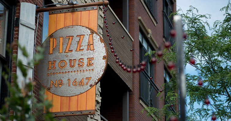 Pizza House 1647 street sign in Chicago