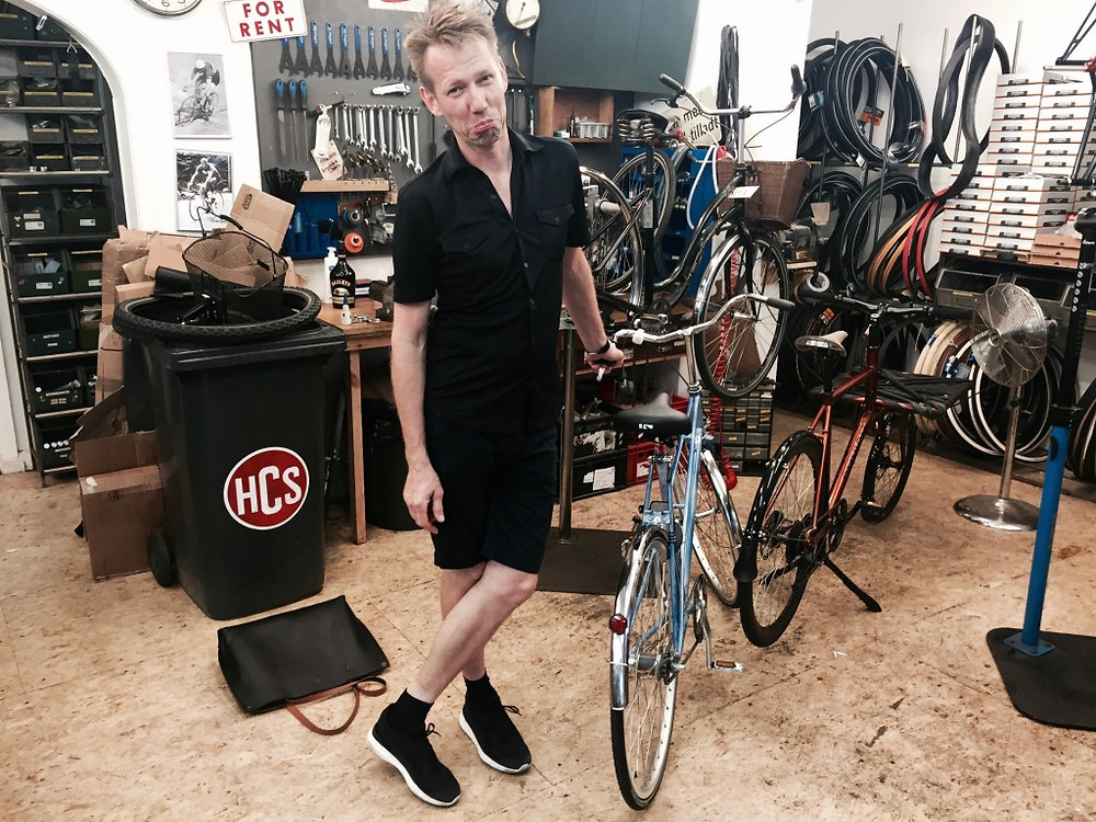 Claus Hjelm of Recycles, mimicking my sad face as I  returned my  sweet bike.  Love that bike!