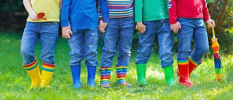 Kids in rain boots. Group of kindergarte