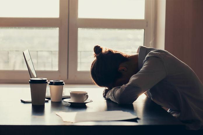 Overworked tired businesswoman sleeping