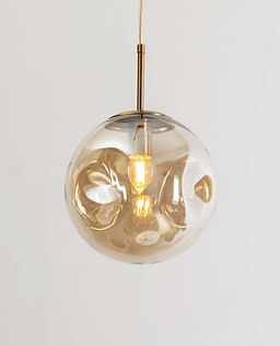golden amber hanging light glass