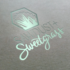 Sawdust and Sweetgrass Logo in Action