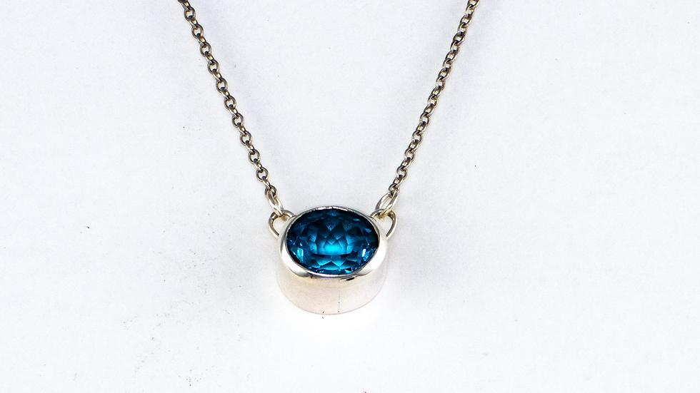 Blue topaz necklace set in sterling silver