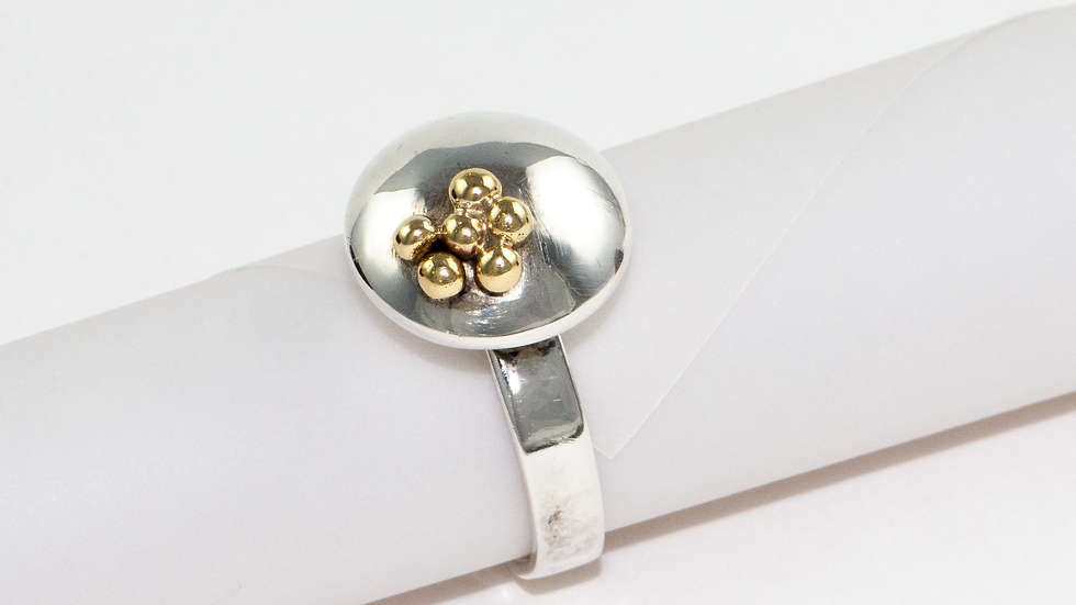Silver pebble ring with gold beads