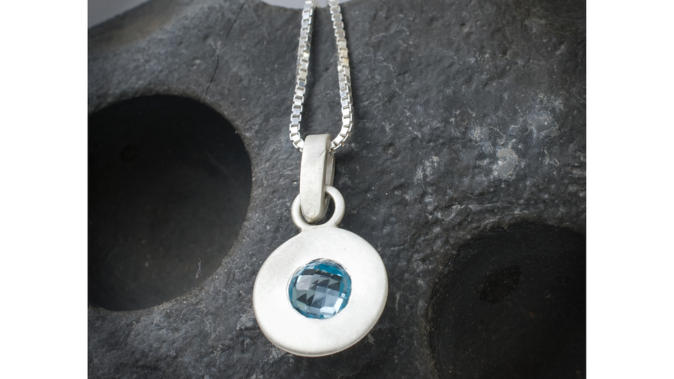 Silver blue topaz circles pendant