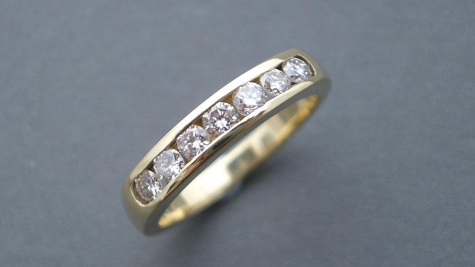 Diamond channel-set half eternity ring