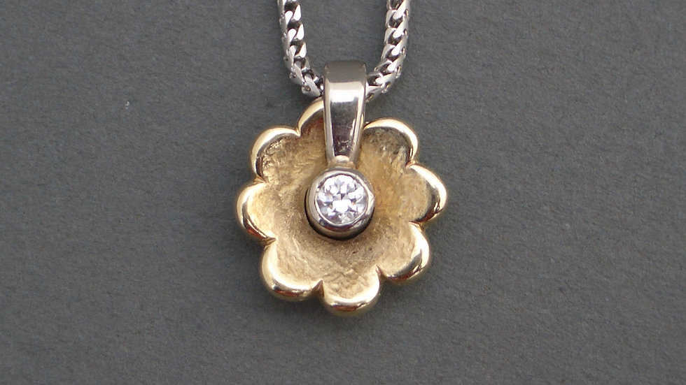 9ct gold and diamond flower pendant (not including chain)