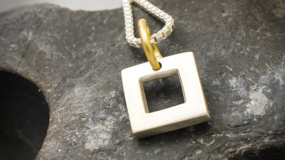 Silver and yellow gold square pendant