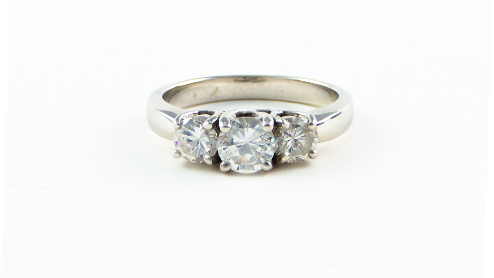 18ct white gold claw set three stone diamond ring