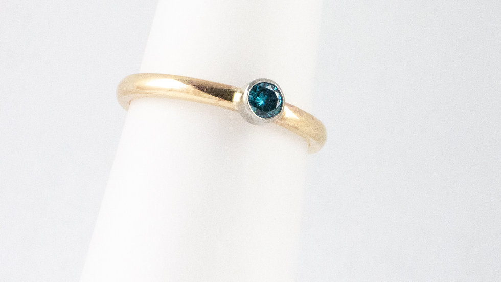 Single stone (treated) blue diamond ring