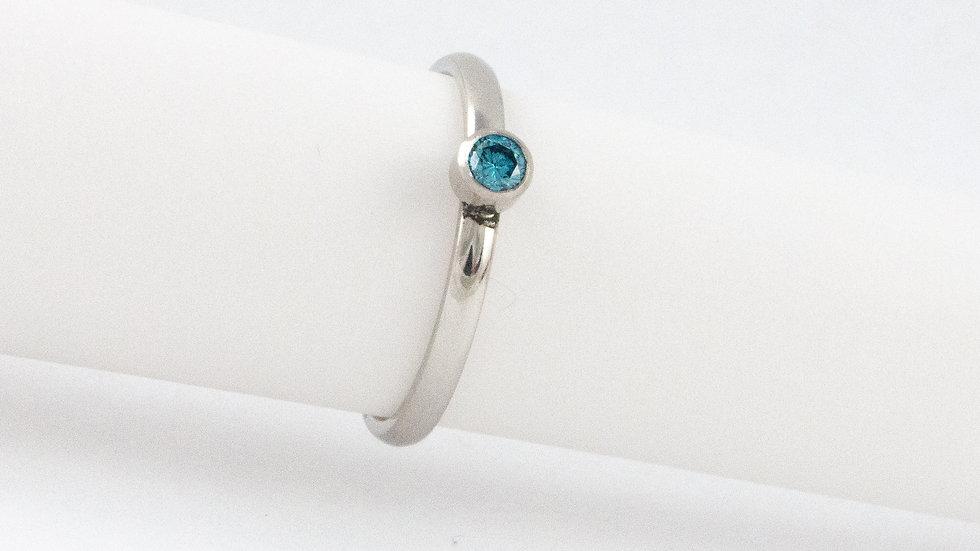 Platinum treated blue diamond ring in platinum