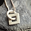Thumbnail: Silver shapes and symbols little square pendant and chain
