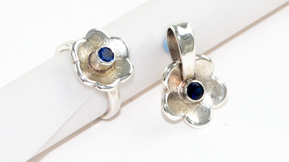 Silver flower ring set with a synthetic sapphire