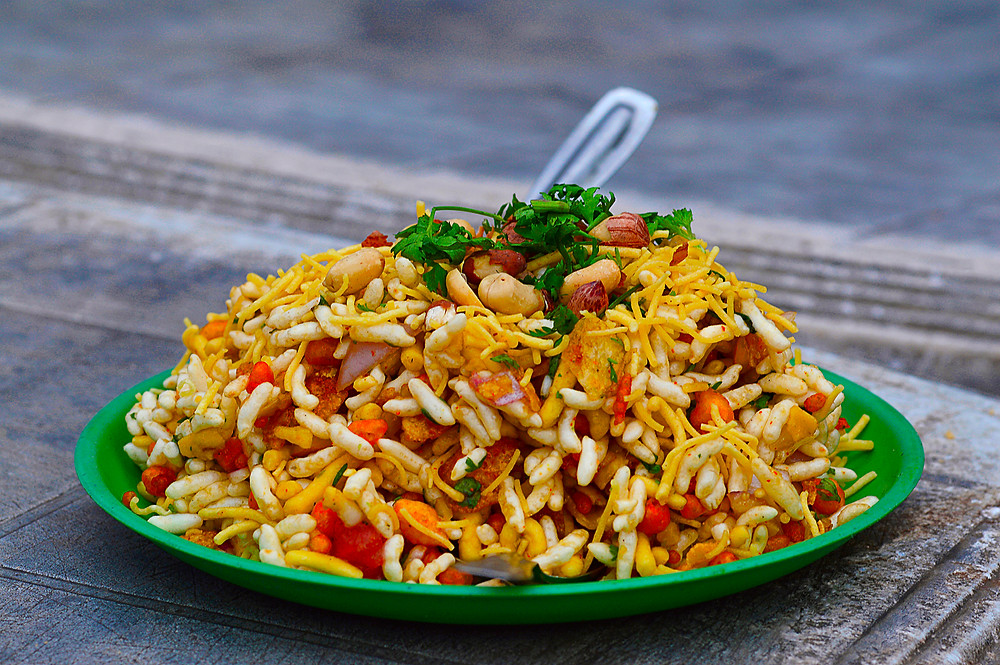 a takeout bowl of bhelpuri chaat