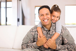 beautiful little daughter and military father at home.jpg