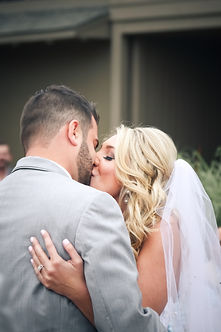 wedding picture at golf club, Lawrence Wedding Photographer, first kiss