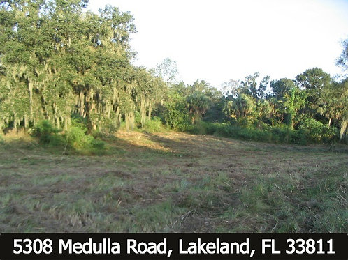 4.15 +/- acre - Residential Acreage with running creek