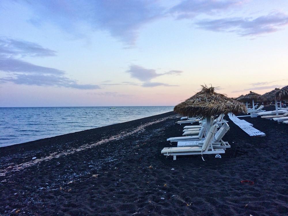 Perivolos black sand beach in Santorini, Greece