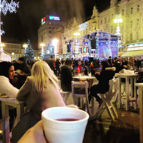 Drinking kuhano vino (mulled wine) at the winter market at Jelačić Square in Zagreb.