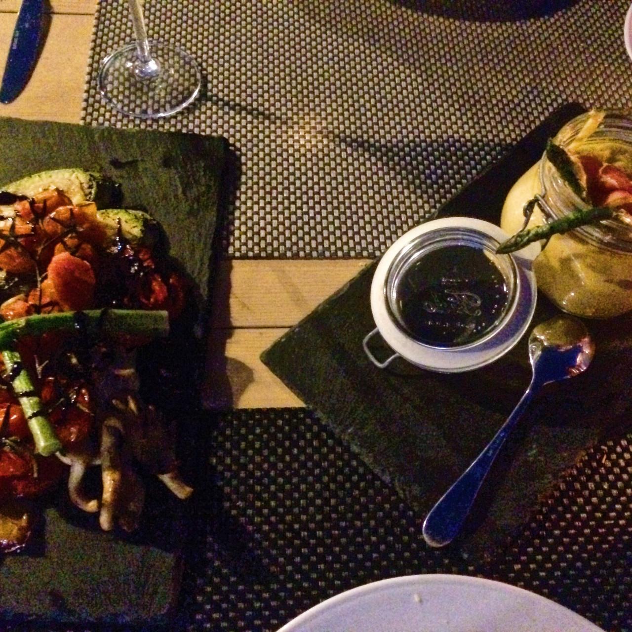 Grilled vegetables marinated with olive oil and Santorinian vinegar, and the white truffle oil fava, grilled asparagus, and prosciutto Serrano at Aegaen Safari restaurant in Perivolos, Santorini, Greece