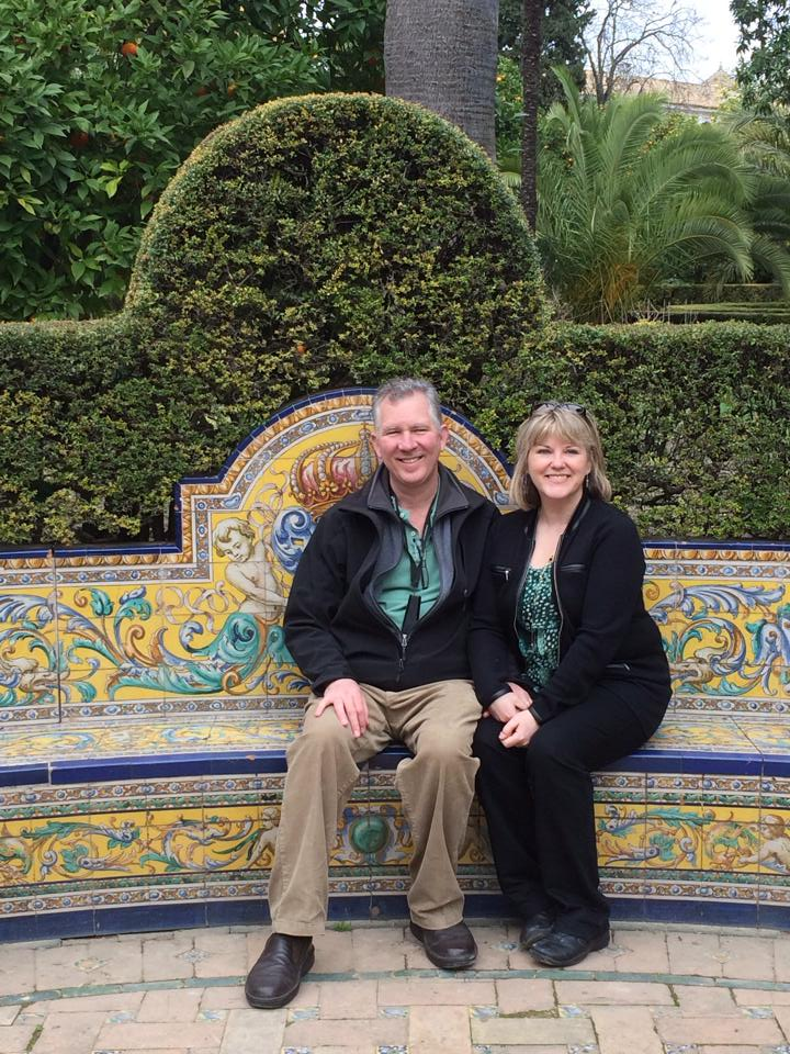 My parents on a tile bench in the gardens
