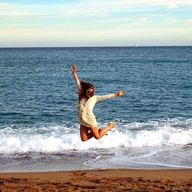 Jumping on the beach in Barcelona Spain