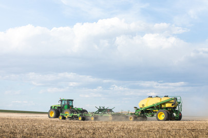 John Deere planting wheat