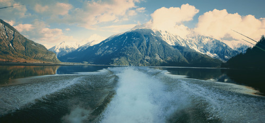 RED Raven 4.5k frame grab of the wake from a Firefish Pirhana jet boat with Bute inlet in the background