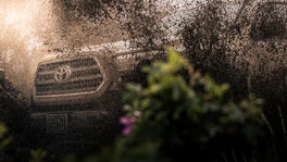 Toyota Tacoma Quicksand Tan TRD Offroad 2018 close up of grill and front end going through mud puddle