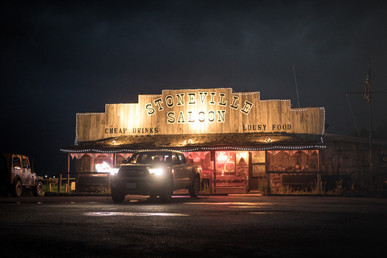 Toyota Tacoma Quicksand Tan TRD Offroad 2018 parked in front of Stoneville Saloon in Montana cheap drinks and lousy food bar