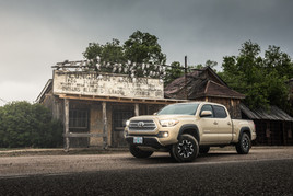 Toyota Tacoma Quicksand Tan TRD Offroad 2018 parked in front of old saloon and jail in ghost town of the Badlands South Dakota