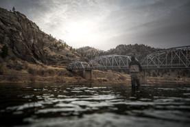 Fly fisherman casting below Hardy Creek Bridge on the Missouri river in Montana durring the fall
