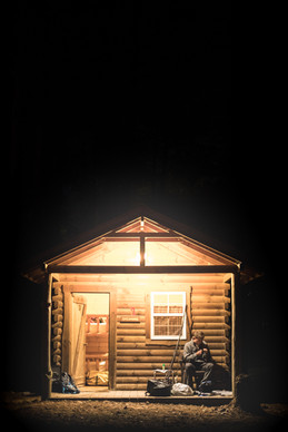 Fisherman Jon B. Fishing the Midwest rigs rods on the porch of a small cabin in Ohio