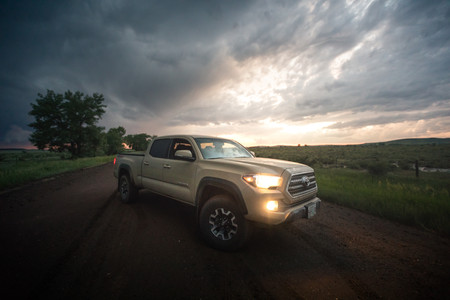 Toyota Tacoma Quicksand Tan TRD Offroad 2018 parked on a muddy road in South East Montana roadtrip