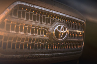 Toyota Tacoma Quicksand Tan TRD Offroad 2018 grill with headlight flare and mud covered