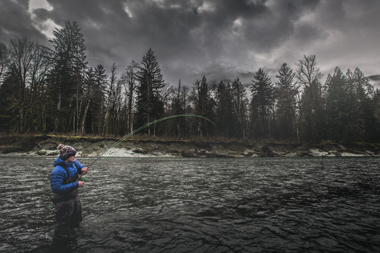 Fly fisherman hooked up on a bull trout
