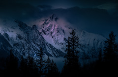 Rugged Vancouver, British Columbia, Canada mountains with an early morning glow, trees in foreground