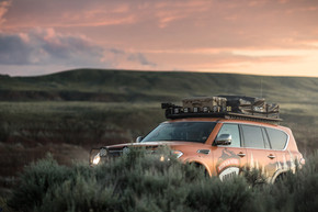 Nissan Armada Mountain Patrol Overland rig with CVT tent, Calmini bumpers, Warn winch, Nitto tires, ARB, and Rhino Rack. Offroad truck