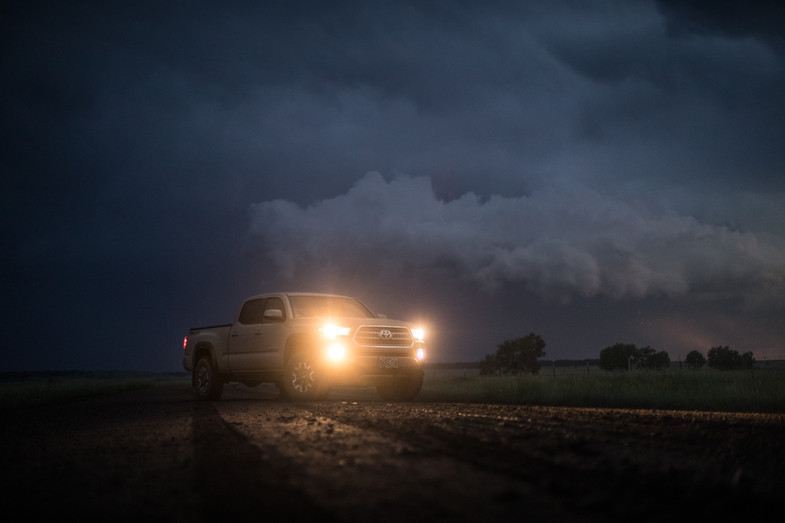 Toyota Tacoma Quicksand Tan TRD Offroad 2018 parked on a dirt road after sunset on a roadtip