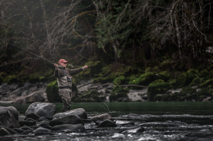 Fly fisherman throwing big streamers for big fish in Canada