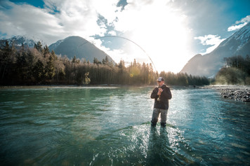 Fly fisherman hooked up on giant Bull Trout in Canada