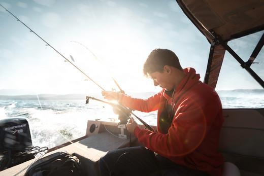 Fisherman Jon B. Fishing the Midwest YouTube rigs Favorite rod in back of boat on Flathead Lake