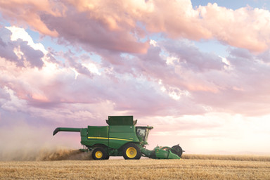 John Deere S790 combine making last cut in field during sunset in Central Montana Golden Triangle  © Blackwall Agency