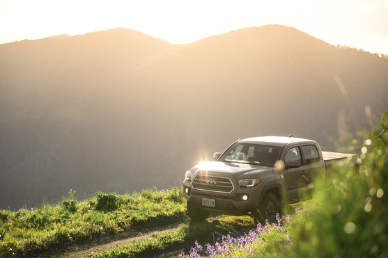 Toyota Tacoma Quicksand Tan TRD Offroad 2018 high up on a mountain at sunset in Montana