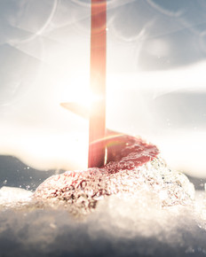 Ice Auger pulling water and ice shavings out with the sun in the background