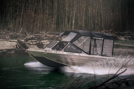 firefish piranha jet boat navigating river in coastal British Columbia